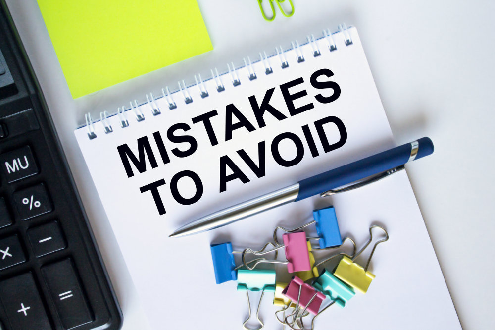 mistakes to avoid written on a page about hiring kitchen and bathroom remodeling companies